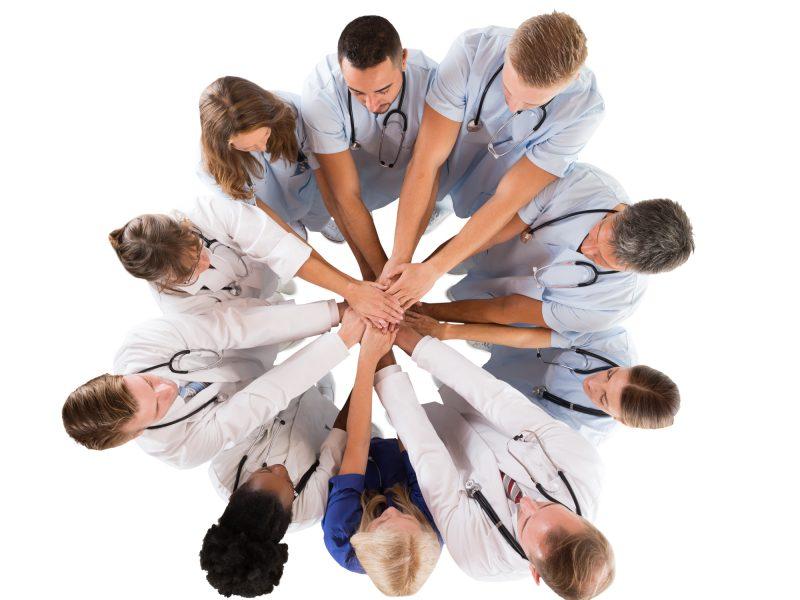medical team hands together